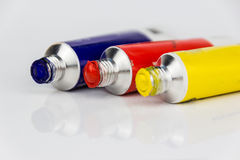 Red, yellow and blue paint tubes macro. Closeup of acrylic paint tubes , blue, red and yellow color royalty free stock photo