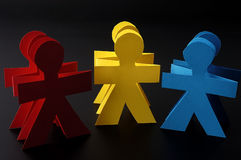 Red yellow and blue paper men Royalty Free Stock Image