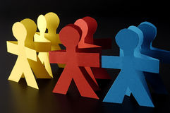 Red yellow and blue paper men Stock Photography