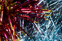 Red, yellow and blue tinsel Stock Photo