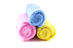 Red yellow and blue towel rolled up. On a white background Stock Photography