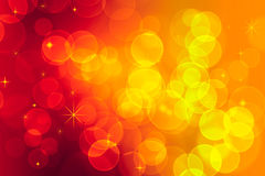Red and yellow bokeh effect. Bright lights bokeh effect in red and yellow with stars royalty free stock image