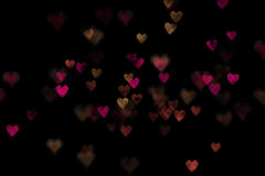Red and yellow bokeh hearts Royalty Free Stock Image