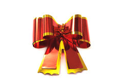 Red-yellow bow foil on a white background. Brilliant red and yellow bow foil on a white background Stock Photography