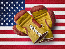 Red and Yellow boxe gloves on USA flag Royalty Free Stock Images