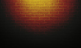 Red and yellow brick wall with light effect and shadow, abstract background photo Stock Photography