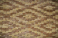 Red and yellow brick wall Stock Photography