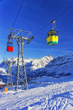 Red and yellow cabins of cable cars at cable railway on winter s Stock Image