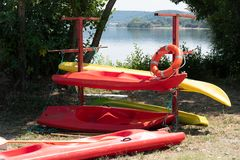 Canoes. Red and Yellow canoes on the shore of a lake royalty free stock photos