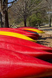 Red and Yellow Canoes Vertical Stock Photos