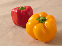 Red and yellow capsicum Stock Images