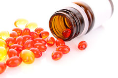 Red and yellow  capsules Stock Photography