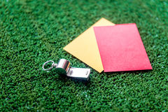 Red and yellow cards on green background close up Stock Photo
