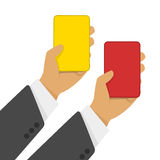 Red and yellow cards in hand Stock Photos