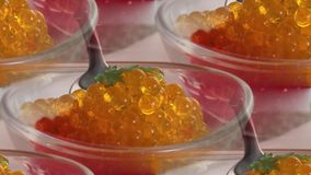Red and yellow caviar in a plate on the table stock photos