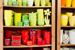 Red and yellow ceramic flowerpots in the florist store Royalty Free Stock Photography