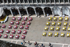 Red and Yellow Chairs and Round Tables Aerial View on Saint Mark Stock Image