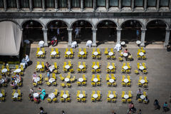 Red and Yellow Chairs and Round Tables Aerial View on Saint Mark Stock Photos
