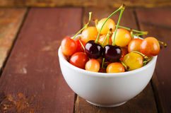 Red and yellow cherries in bowl Stock Image