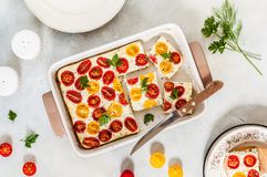 Tomato and Cottage Cheese Bake. Red and Yellow Cherry Tomato and Cottage Cheese Bake royalty free stock images