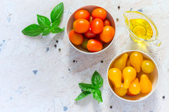 Red and yellow cherry tomatoes in bowls. Top view with copy spac Royalty Free Stock Photography