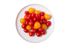 Red, yellow cherry tomatoes on plate isolated Stock Photography