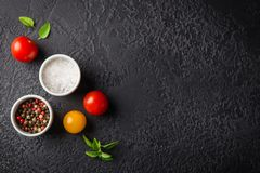 Red and yellow fresh tomatos, basil and olive oil royalty free stock images