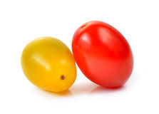 Red and yellow cherry tomatoes  on white background. Stock Photos