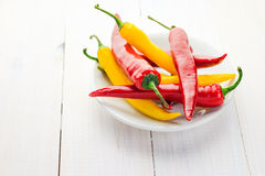 Red yellow chili peppers served plate Royalty Free Stock Images