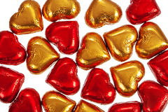 Red and yellow chocolate candies on white Royalty Free Stock Images
