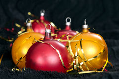 Red and yellow Christmas balls on a black backdrop Stock Photography