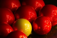Red and yellow christmas balls reflecting christmas tree royalty free stock photography