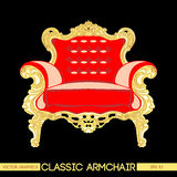 Red and yellow classic armchair over dark background Royalty Free Stock Image