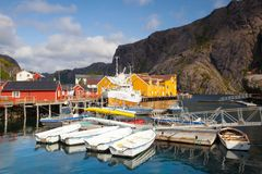 Red and yellow classic Norwegian Rorbu fishing huts, Nusfjord on. Nusfjord, Norway - August 21,2017: Red and yellow classic Norwegian Rorbu fishing huts stock image