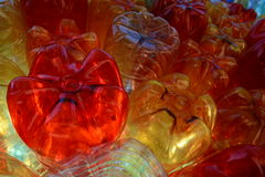 Red yellow clear plast bottles Stock Photography
