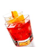 Red and yellow cocktail with orange slice isolated on white background Royalty Free Stock Photo