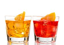 Red and yellow cocktail with orange slice on top isolated on white background Stock Photos
