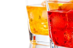 Red and yellow cocktail with orange slice  on white background Royalty Free Stock Photos