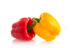 Red and yellow color of chili peppers isolated on white backgrou Stock Photos