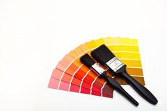 Red and yellow colour selectors. Paint brushes with red, yellow, orange and brown colour swatches Royalty Free Stock Image