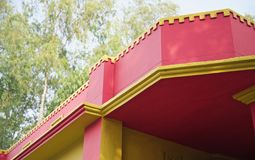 Red and yellow concrete roof of a house. Beautiful red and yellow concrete roof of a house  unique photo stock image