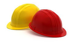 Red and yellow construction helmet Royalty Free Stock Photography