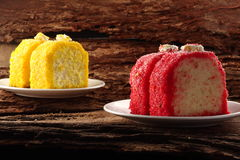 Red and yellow cream cakes Stock Images