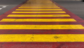 Red yellow crosswalk on the road Royalty Free Stock Photo