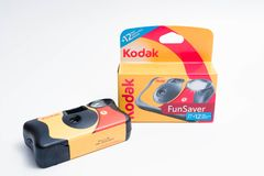 Geneva/Switzerland – 03.03.2019 : Disposable Camera 35mm analog photogrpahy Kodak fun saver. Red yellow disposable camera from kodak for kids or event royalty free stock image