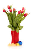 Red yellow Easter tulips vase Royalty Free Stock Photo