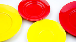 Red and yellow empty plate Royalty Free Stock Photos