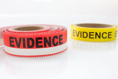 Red and yellow evidence tape on white background Stock Photography