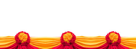 Red and yellow fabric decoration isolated on white Stock Photos