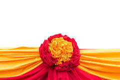 Red and yellow fabric decoration isolated on white. Saved with c Royalty Free Stock Photography